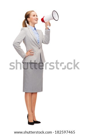 business, communication and office concept - smiling businesswoman with megaphone screaming at someone imaginary