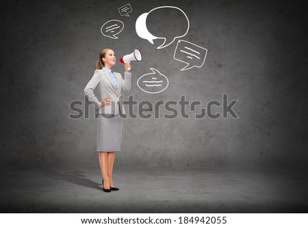 business, communication and office concept - smiling businesswoman with megaphone screaming at someone imaginary - stock photo