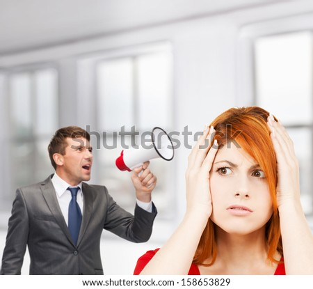 business, communication, hiring, searching, public announcement, office concept - buisnessman with bullhorn or megaphone and stressed woman - stock photo