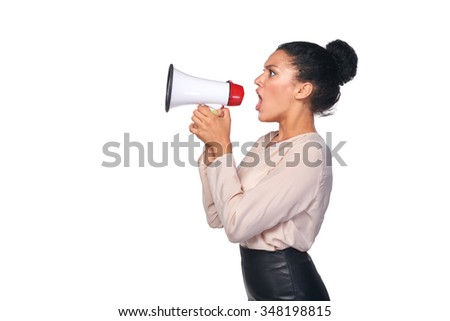 Business, communication, information concept. Side view of angry serious mixed race caucasian - african american business woman screaming into loudspeaker  - stock photo