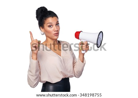 Business, communication, information concept. Surprised mixed race caucasian - african american business woman holding loudspeaker and pointing her finger up - stock photo