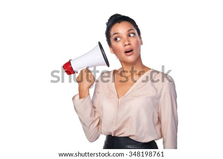 Business, communication, information concept. Surprised mixed race caucasian - african american business woman holding loudspeaker listening to it