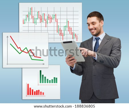 business, communication, modern technology and office concept - smiling buisnessman with tablet pc computer - stock photo