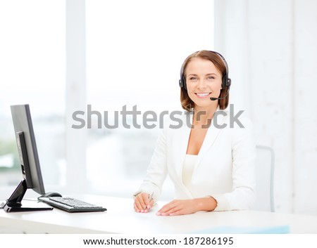 business, communication, technology and call center concept - friendly female helpline operator with headphones and computer call center - stock photo