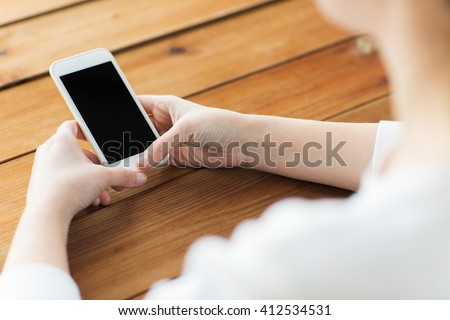 business, communication, technology and internet concept - close up of woman texting on smartphone - stock photo