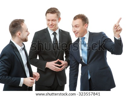 Business communication. Three cheerful business men talking to each other and gesturing. Isoated on white. - stock photo