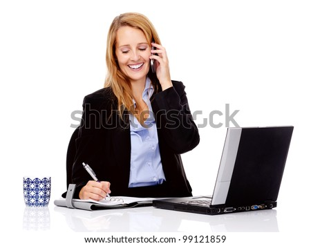 Business communication woman is working at her desk and talking on the phone - stock photo