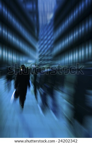 business commuters in the rush hour with motion blur effect - stock photo