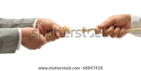 Business competition - businessman and woman struggling to win. - stock photo