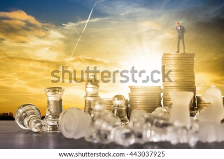 Business competition chess battle strategy game. Businessman stand over a chess and money after victory. - stock photo