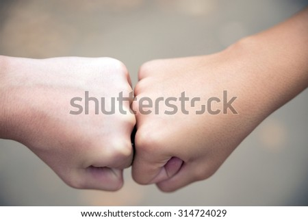 business competition concept-Collision Course Fists - stock photo