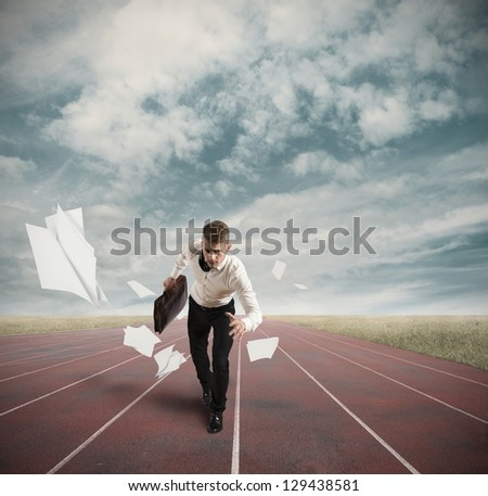 Business Competition with running businessman on the track - stock photo