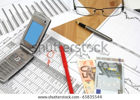 Business composition. Financial analysis - income statement, finance charts, red marker, Euro money and a mobile phone. - stock photo