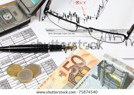 Business composition. Financial analysis - income statement, finance graphs, generic phone, Euro money and a fountain pen. - stock photo