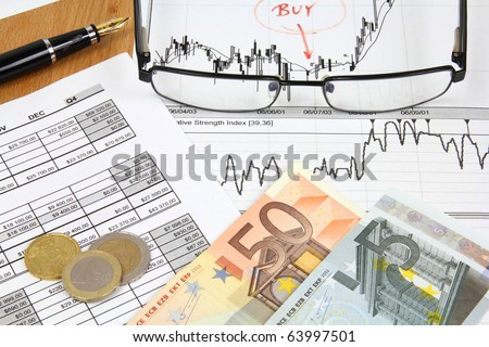 Business composition. Financial analysis - income statement, ink pen, glasses and Euro money.