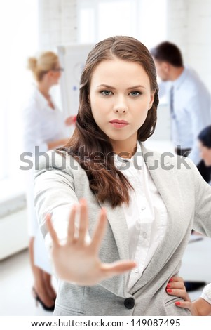 business concept - angry businesswoman showing stop gesture - stock photo