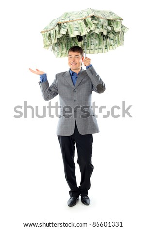 Business concept: businessman holding an umbrella of money. Isolated over white.