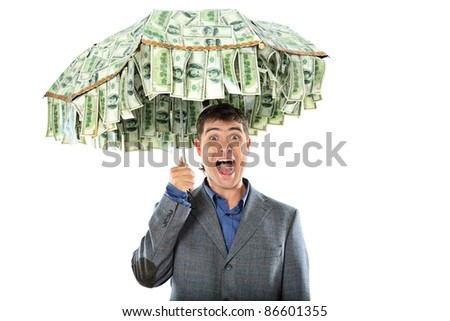 Business concept: businessman holding an umbrella of money. Isolated over white. - stock photo