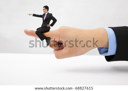 Business concept.Businessman sitting on the finger  shouting and blaming - stock photo