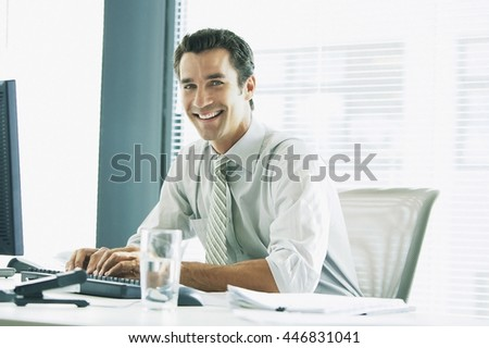 Business concept - businessman working in office - stock photo