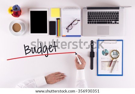 Business Concept: Businessman writing the words BUDGET - stock photo