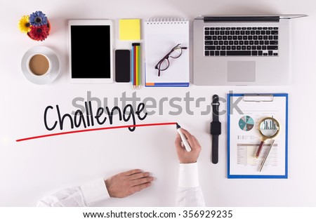 Business Concept: Businessman writing the words CHALLENGE - stock photo