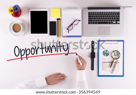 Business Concept: Businessman writing the words OPPORTUNITY - stock photo