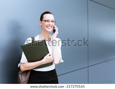 Business concept - Businesswoman talking on the phone - stock photo