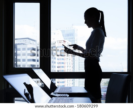 Business concept - Businesswoman using mobile phone in the office  - stock photo