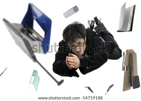 Business concept: businesswoman with glasses  diving between office items on white background