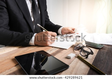 Business concept, Bussiness man working with bill and notebook on wooden table