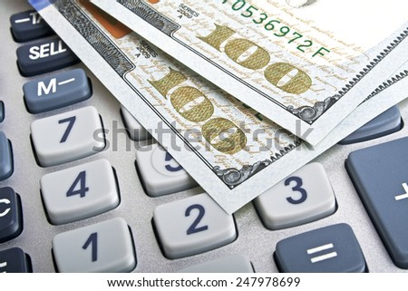 Business concept - calculator and money