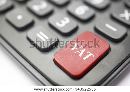 Business concept Calculator button bold in red with VAT written on it. - stock photo