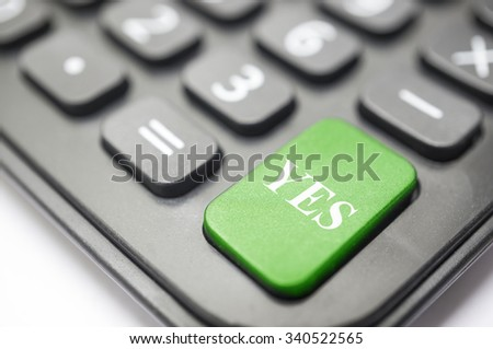 Business concept Calculator button bold in red with Yes written on it.