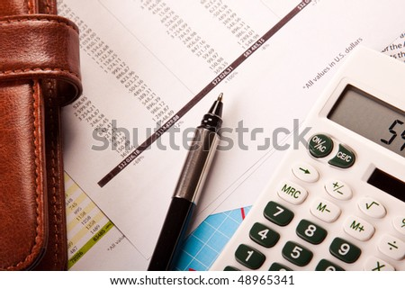 Business Concept, calculator pen and wallet - stock photo
