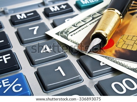 Business concept, calculator, pen, credit card and money - stock photo