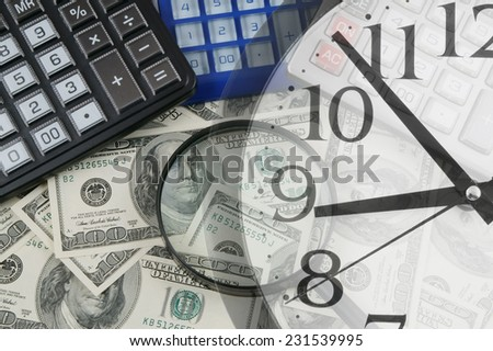 Business concept, calculators and magnifying glass on dollar banknotes