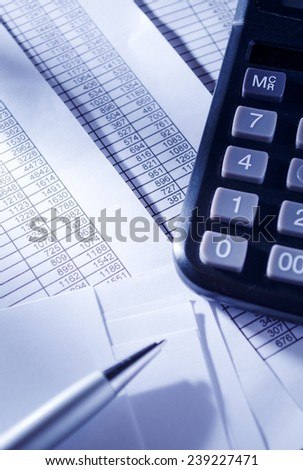 Business Concept - Close up Black Calculator and Ballpoint Pen on Top of Sales Invoice Reports. - stock photo