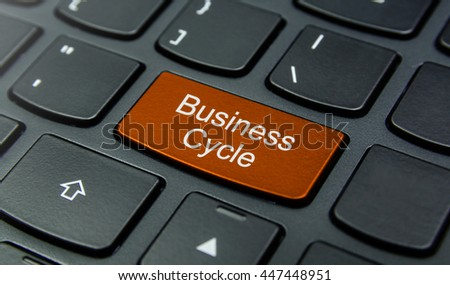 Business Concept: Close-up the Business Cycle button on the keyboard and have Orange color button isolate black keyboard - stock photo