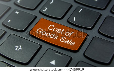 Business Concept: Close-up the Cost of Goods Sale button on the keyboard and have Orange color button isolate black keyboard