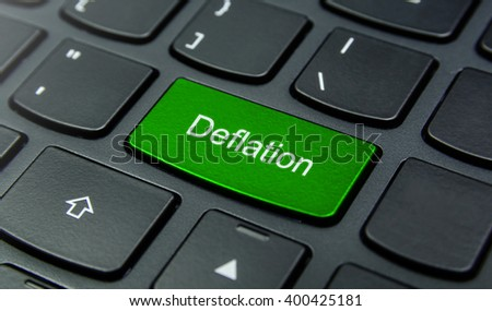 Business Concept: Close-up the Deflation button on the keyboard and have Lime, Green color button isolate black keyboard