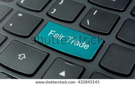 Business Concept: Close-up the Fair Trade button on the keyboard and have Azure, Cyan, Blue, Sky color button isolate black keyboard - stock photo