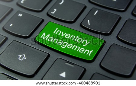 Business Concept: Close-up the Inventory Management button on the keyboard and have Lime, Green color button isolate black keyboard - stock photo