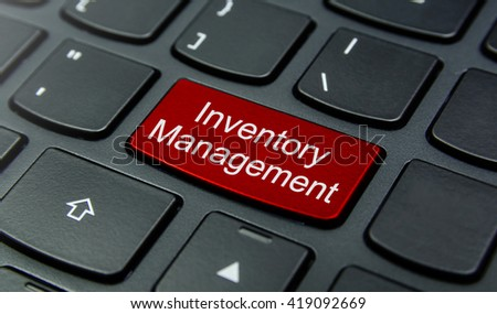 Business Concept: Close-up the Inventory Management button on the keyboard and have Red color button isolate black keyboard - stock photo