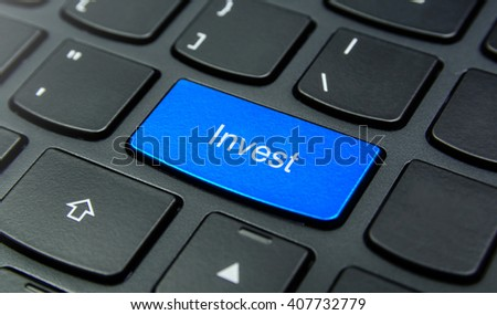 Business Concept: Close-up the Invest button on the keyboard and have Azure, Cyan, Blue, Sky color button isolate black keyboard