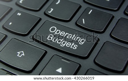 Business Concept: Close-up the Operating Budgets button on the keyboard and have Black color button isolate black keyboard