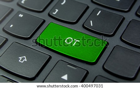 Business Concept: Close-up the OT button on the keyboard and have Lime, Green color button isolate black keyboard