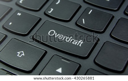 Business Concept: Close-up the Overdraft button on the keyboard and have Black color button isolate black keyboard - stock photo