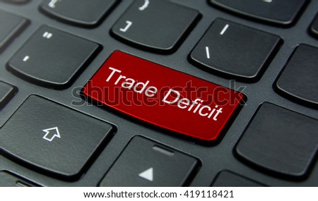Business Concept: Close-up the Trade Deficit button on the keyboard and have Red color button isolate black keyboard