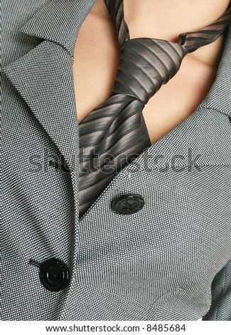 business concept, detail of a business woman suit with a tie